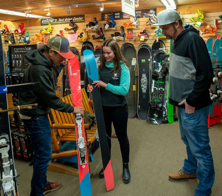 Customer browsing the selection of skis for sale at Abominable Sports in Banff, Alberta.