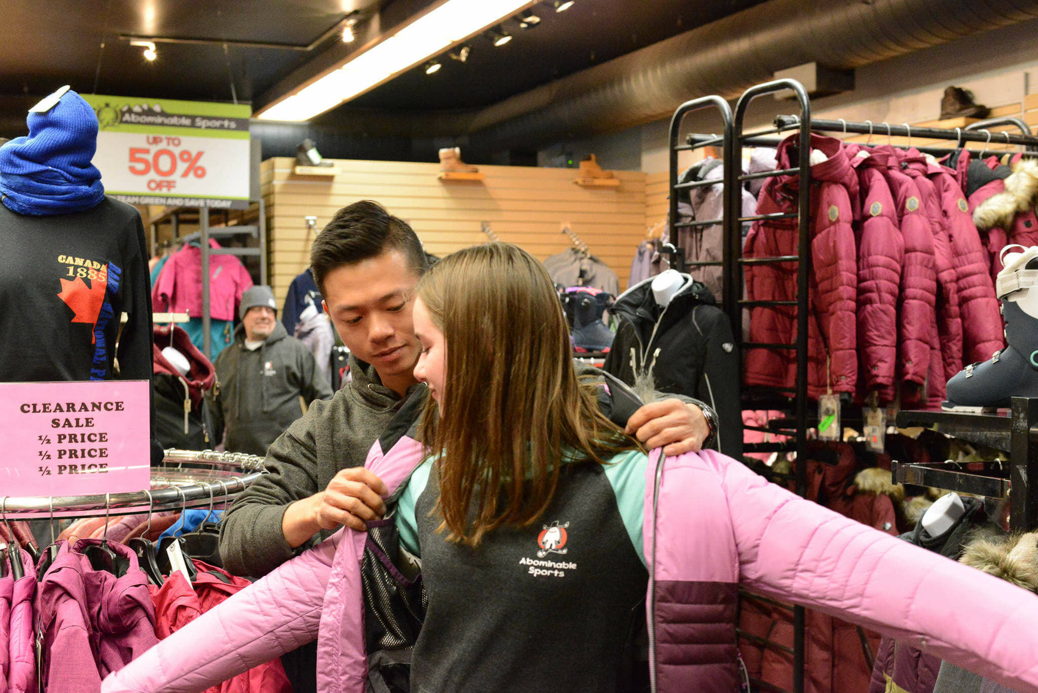 Customer buying women's ski outerwear from Abominable Sports in Banff, Alberta.